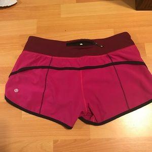 lululemon athletica Shorts - Lululemon pink and black speed shorts, size 6